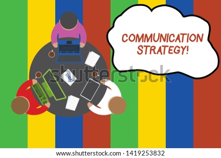 Conceptual hand writing showing Communication Strategy. Business photo showcasing Verbal Nonverbal or Visual Plans of Goal and Method Working table male employees electronic devices coffee cup.
