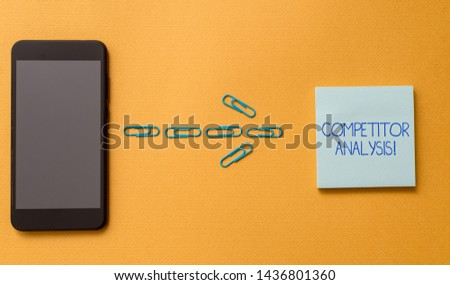 Conceptual hand writing showing Competitor Analysis. Business photo text Determine the Strength Weakness of Competitive Market Colored blank sticky note clips smartphone cool pastel background.