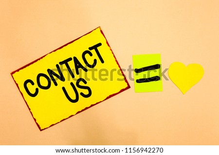 Conceptual hand writing showing Contact Us. Business photo text Group of person that rendering costumer service through telecom Yellow paper reminder equal sign heart sending romantic feelings.