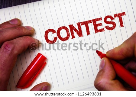 Conceptual hand writing showing Contest. Business photo showcasing Game Tournament Competition Event Trial Conquest Battle Struggle Man hold holding marker paper thoughts messages intentions. #1126493831