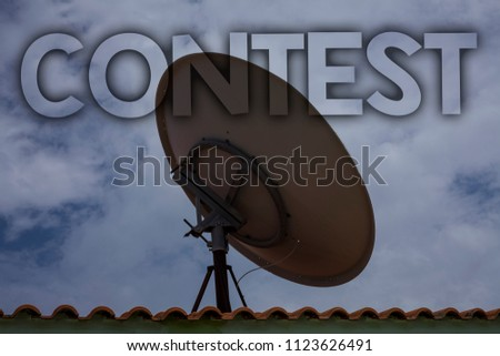 Conceptual hand writing showing Contest. Business photo text Game Tournament Competition Event Trial Conquest Battle Struggle Ideas messages television antenna cloudy sky old city house. #1123626491