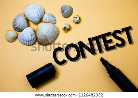 Conceptual hand writing showing Contest. Business photo text Game Tournament Competition Event Trial Conquest Battle Struggle Yellow background shadow open marker shells beach memory memories. #1126482332