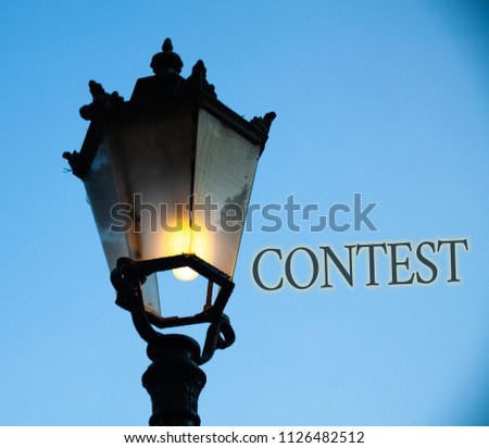 Conceptual hand writing showing Contest. Business photo text Game Tournament Competition Event Trial Conquest Battle Struggle Light post blue sky enlighten ideas old vintage antique Victorian. #1126482512