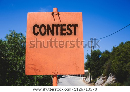 Conceptual hand writing showing Contest. Business photo text Game Tournament Competition Event Trial Conquest Battle Struggle Wooden board post ideas blue sky trees antique vintage landscape. #1126713578