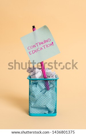Conceptual hand writing showing Continuing Education. Business photo text Continued Learning Activity professionals engage in crumpled paper and stationary with paper placed in the trash can. #1436801375