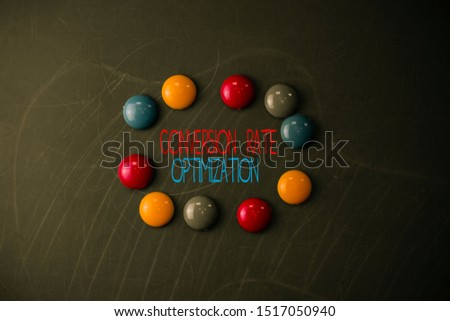 Conceptual hand writing showing Conversion Rate Optimization. Business photo showcasing system for increasing percentage of visitors Round Flat shape stones with same sizes stick black board.