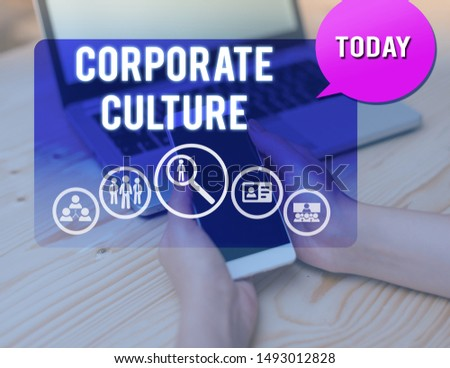 Conceptual hand writing showing Corporate Culture. Business photo showcasing pervasive values and attitudes that characterize a company woman smartphone speech bubble office supplies technology. #1493012828