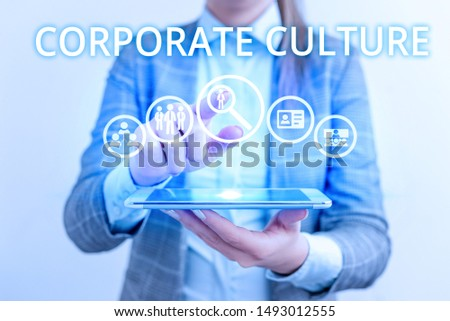 Conceptual hand writing showing Corporate Culture. Business photo text pervasive values and attitudes that characterize a company Lady front presenting hand blue glow futuristic modern technology. #1493012555