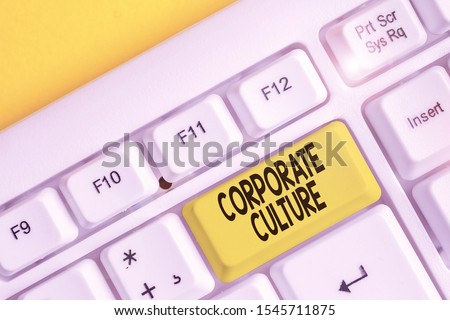 Conceptual hand writing showing Corporate Culture. Business photo text pervasive values and attitudes that characterize a company White pc keyboard with note paper above the white background.