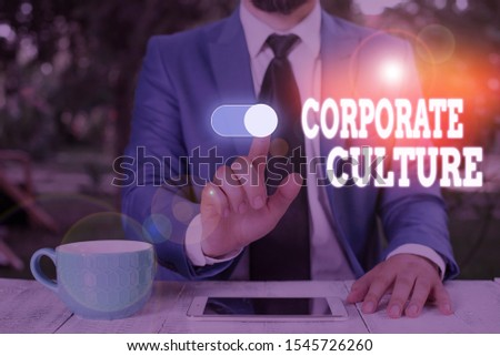Conceptual hand writing showing Corporate Culture. Business photo text pervasive values and attitudes that characterize a company Male wear formal work suit presenting presentation smart device.