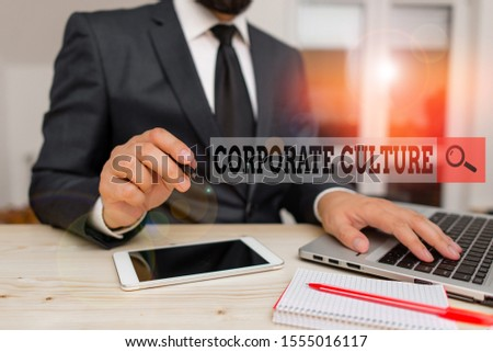 Conceptual hand writing showing Corporate Culture. Business photo text pervasive values and attitudes that characterize a company Male human wear formal clothes present use hitech smartphone.