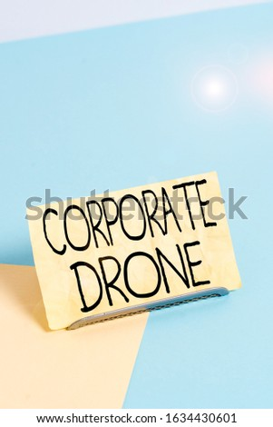 Conceptual hand writing showing Corporate Drone. Business photo showcasing unmanned aerial vehicles used to monitor business vicinity Paper on buffer wire on soft pastel multi colours backdrop.