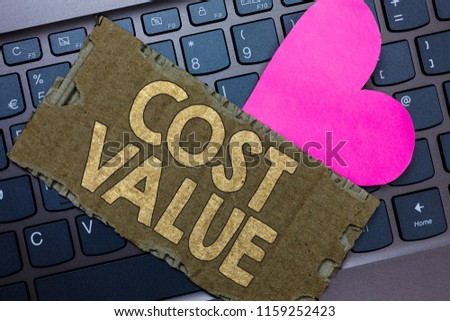 Conceptual hand writing showing Cost Value. Business photo text The amount that usualy paid for a item you buy or hiring a person Paperboard Romantic lovely message Heart Keyboard Type computer. #1159252423