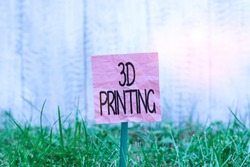 Conceptual hand writing showing 3D Printing. Business photo text making a physical object from a threedimensional digital model Plain paper attached to stick and placed in the grassy land.