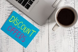 Conceptual hand writing showing Discount Offers. Business photo text amount or percentage deducted from the normal selling price Metallic laptop blank sticky note coffee cup lying vintage table.