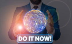 Conceptual hand writing showing Do It Now. Business photo showcasing not hesitate and start working or doing stuff right away Elements of this image furnished by NASA.