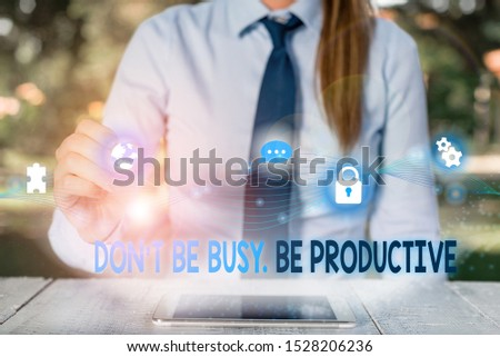 Conceptual hand writing showing Don T Be Busy Be Productive. Business photo showcasing Work efficiently Organize your schedule time Female human wear formal work suit presenting smart device. #1528206236