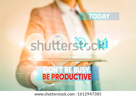 Conceptual hand writing showing Don T Be Busy Be Productive. Business photo showcasing Work efficiently Organize your schedule time Female human wear formal work suit presenting smart device.