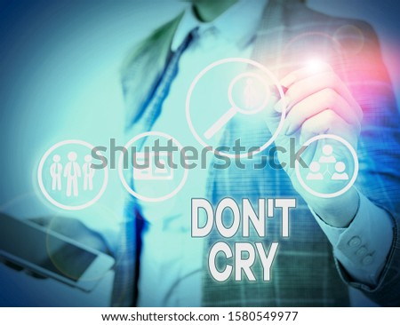 Conceptual hand writing showing Don T Cry. Business photo text Shed tears typically as an expression of distress pain or sorrow. #1580549977
