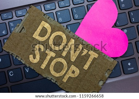 Conceptual hand writing showing Don t not Stop. Business photo text Continue what had been doing without rendering a delay Paperboard Romantic lovely message Heart Keyboard Type computer. #1159266658