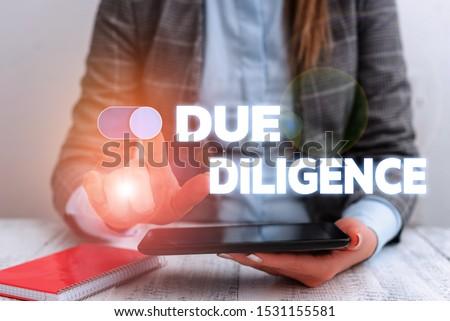 Conceptual hand writing showing Due Diligence. Business photo showcasing Comprehensive Appraisal Voluntary Investigation Audit Business concept with communication mobile phone.