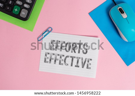 Conceptual hand writing showing Efforts Effective. Business photo showcasing Produces the results as per desired Goal Target Achieve Wire electronic mouse calculator paper colored background.