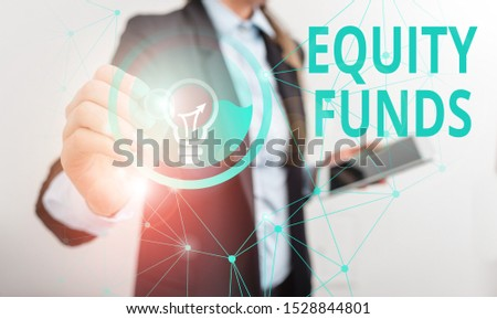 Conceptual hand writing showing Equity Funds. Business photo showcasing type of mutual fund that buys ownership in businesses Male human wear formal suit presenting using smart device.