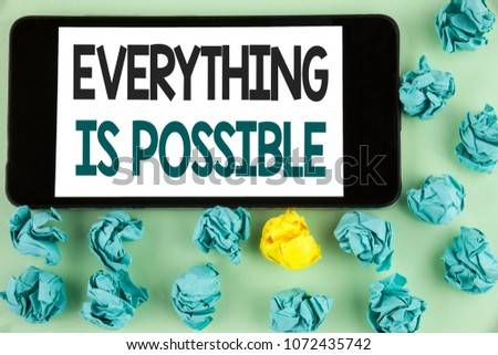 Conceptual hand writing showing Everything Is Possible. Business photo text All you think or dream can become true Optimistic written Mobile Phone Screen the plain background Paper Balls. #1072435742