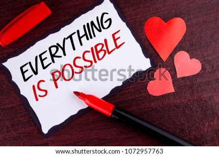 Conceptual hand writing showing Everything Is Possible. Business photo text All you think or dream can become true Optimistic written Sticky Note Paper wooden background Marker and Hearts #1072957763