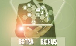 Conceptual hand writing showing Extra Bonus. Business photo showcasing an extra amount of money that is added to someone s is pay.
