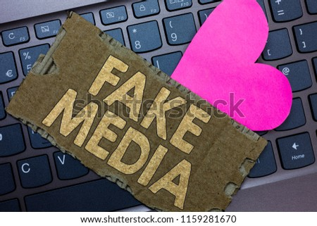 Conceptual hand writing showing Fake Media. Business photo text An formation held by brodcasters which we cannot rely on Paperboard Romantic lovely message Heart Keyboard Type computer. #1159281670
