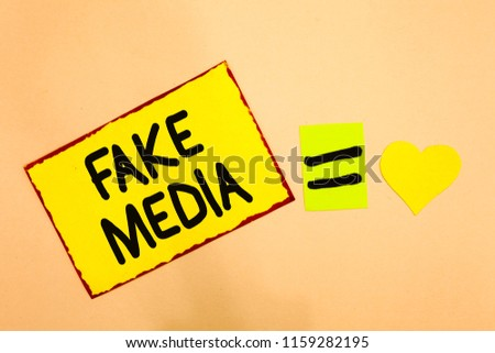 Conceptual hand writing showing Fake Media. Business photo text An formation held by brodcasters which we cannot rely on Yellow paper reminder equal sign heart sending romantic feelings. #1159282195