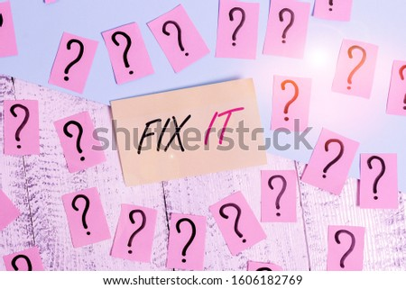 Conceptual hand writing showing Fix It. Business photo text Fasten something securely in a particular place or position To repair Crumbling papers with thick cardboard on the wooden table.