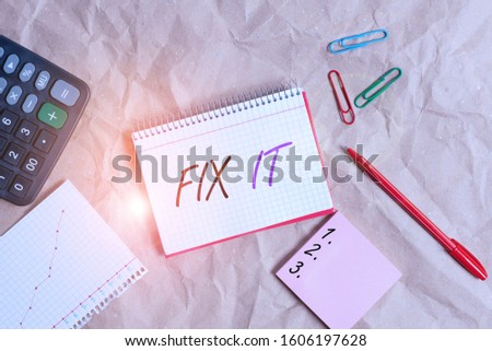 Conceptual hand writing showing Fix It. Business photo text Fasten something securely in a particular place or position To repair Papercraft desk square spiral notebook office study supplies.