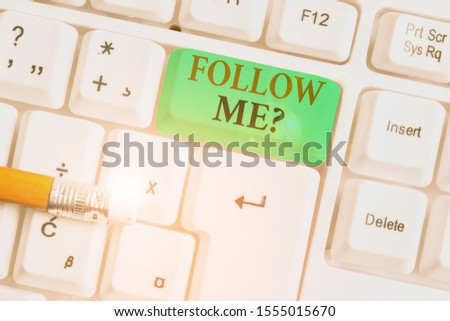 Conceptual hand writing showing Follow Me Question. Business photo showcasing go or come after demonstrating or thing proceeding ahead White pc keyboard with note paper above the white background. #1555015670