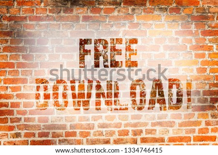 Conceptual hand writing showing Free Download. Business photo showcasing Files Downloading Without Any Charges Online Technology Brick Wall art like Graffiti motivational written on wall. #1334746415