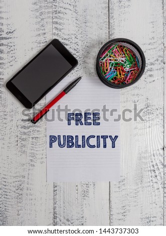 Conceptual hand writing showing Free Publicity. Business photo text Promotional marketing Mass media Public Relations Editorial Smartphone paper sheet clips ballpoint wooden vintage background.