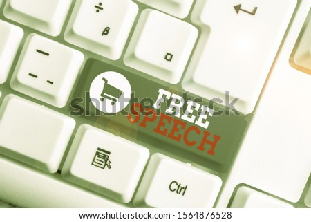 Conceptual hand writing showing Free Speech. Business photo showcasing the right of showing to express their opinions publicly White pc keyboard with note paper above the white background.