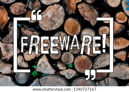 Conceptual hand writing showing Freeware. Business photo showcasing Software Application that is available for use at no monetary cost Wooden background vintage wood wild message ideas thoughts.
