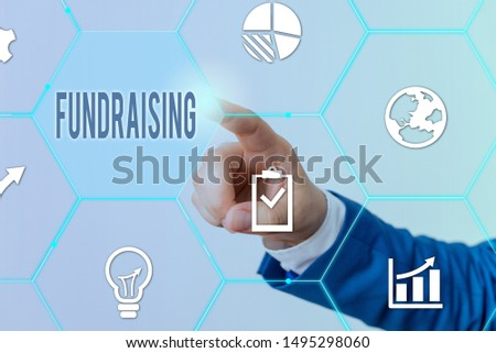 Conceptual hand writing showing Fundraising. Business photo showcasing act of collecting or producing money for a particular purpose Male human wear formal suit presenting using smart device.