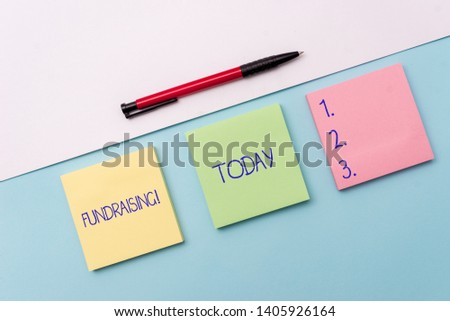 Conceptual hand writing showing Fundraising. Business photo showcasing seeking to generate financial support for charity or cause Stationary placed sideways on top of the softhued backdrop. #1405926164