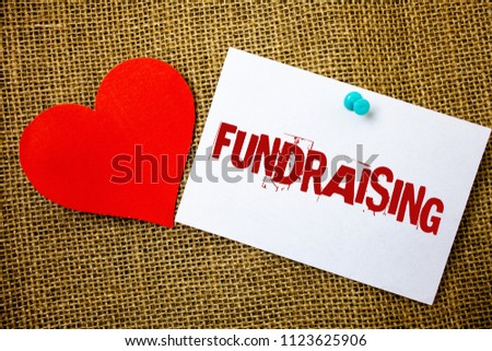 Conceptual hand writing showing Fundraising. Business photo text Seeking of financial support for charity cause or enterprise Message note jute background red heart letters love grunge idea. #1123625906