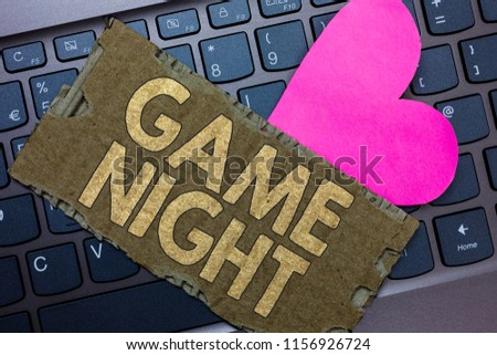 Conceptual hand writing showing Game Night. Business photo text event in which folks get together for the purpose of getting laid Paperboard Romantic lovely message Heart Keyboard Type computer. #1156926724