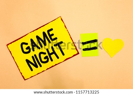 Conceptual hand writing showing Game Night. Business photo text event in which folks get together for the purpose of getting laid Yellow paper reminder equal sign heart sending romantic feelings. #1157713225