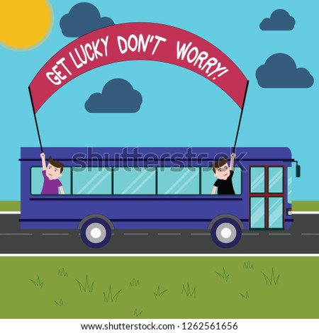 Conceptual hand writing showing Get Lucky Don T Worry. Business photo showcasing Stop worrying and have a good fortune luck success Two Kids Inside School Bus Holding Out Banner with Stick.