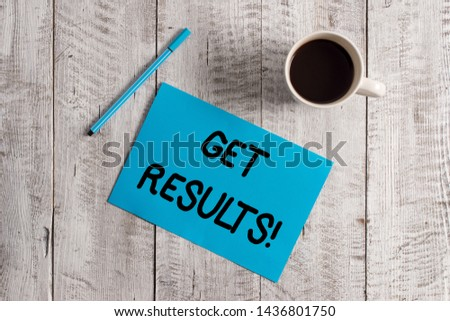 Conceptual hand writing showing Get Results. Business photo showcasing caused or produced by something else Consequence outcome Pastel Colour paper and pen with coffee cup on wooden table.