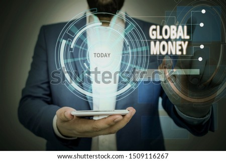 Conceptual hand writing showing Global Money. Business photo showcasing International finance World currency Transacted globally Male wear formal suit presenting presentation smart device. #1509116267