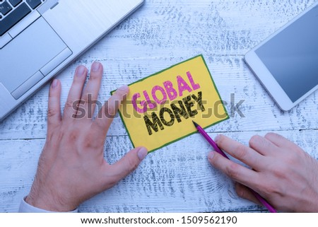 Conceptual hand writing showing Global Money. Business photo showcasing International finance World currency Transacted globally. #1509562190