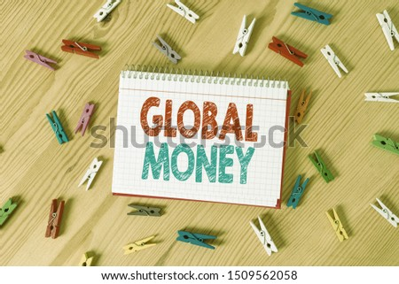Conceptual hand writing showing Global Money. Business photo text International finance World currency Transacted globally Colored crumpled papers wooden floor background clothespin. #1509562058