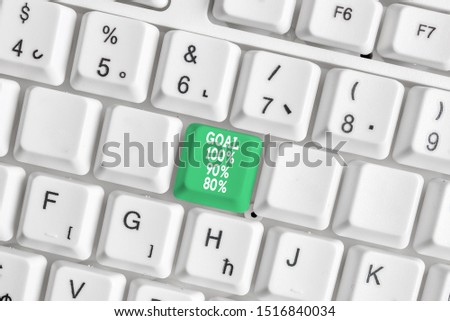 Conceptual hand writing showing Goal 100 Percent 90 Percent 80 Percent. Business photo showcasing Percentage of your objectives fulfilment success level White pc keyboard with note paper above the